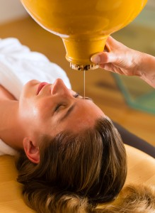 Woman enjoying a Ayurveda oil massage treatment
