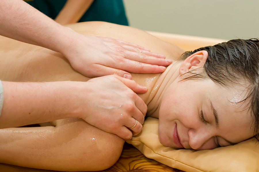 ayurvedic therapy: massage procedure with oil and pouch of rice and spices